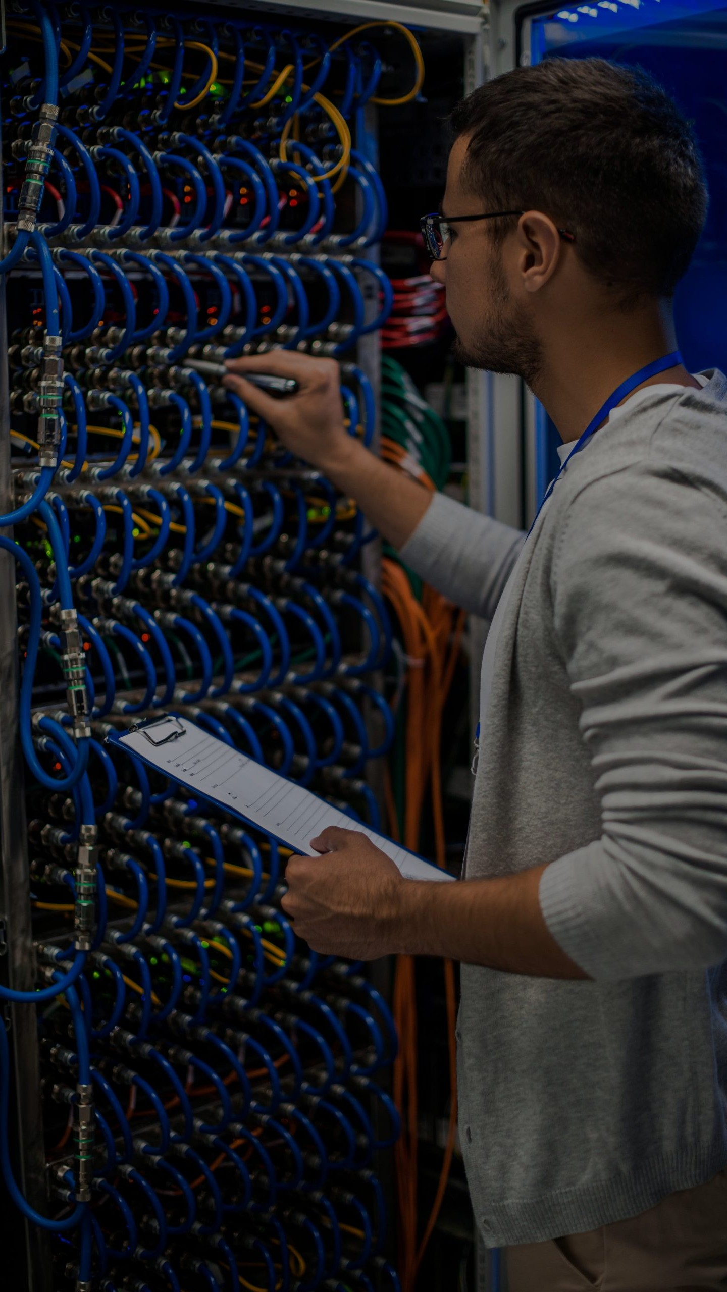 IT Specialist checking network security on a server in dallas